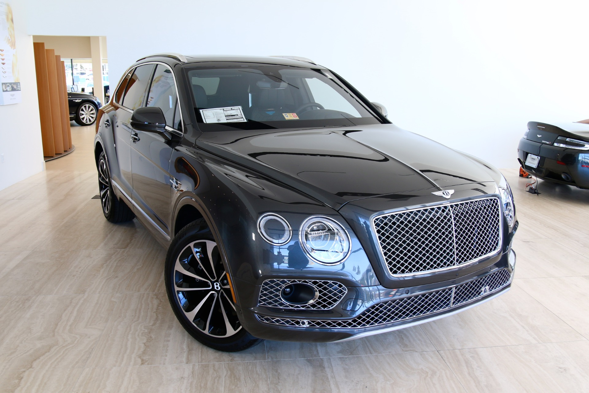 front in three an trend dealer news is motor bentayga maryland quarter ultra suv lux hybrid bentley plug